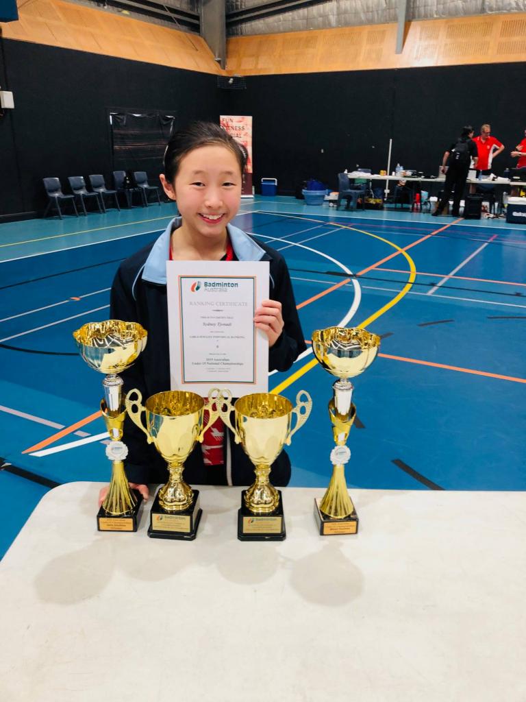 Sydney Tjonadi won the WD and XD titles in the U15 Australian Badminton Championship in Queensland